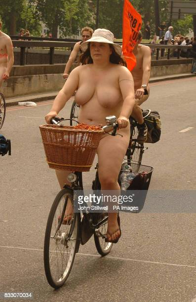 Naked environmental campaigners take part in the World Naked Bike Ride in protest against the world's use of oil in Piccadilly central London