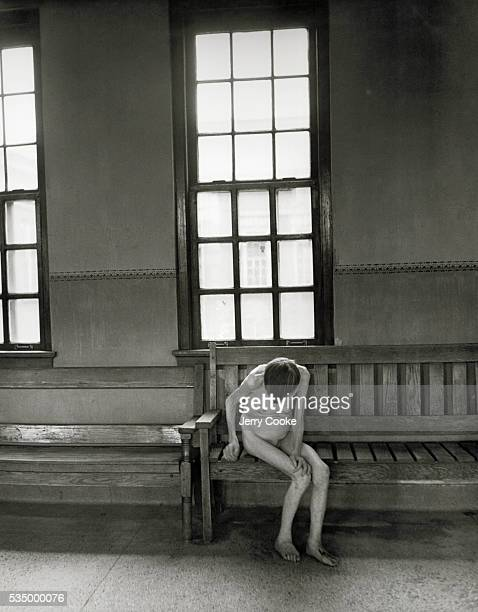 Naked Female Psychiatric Patient in Asylum