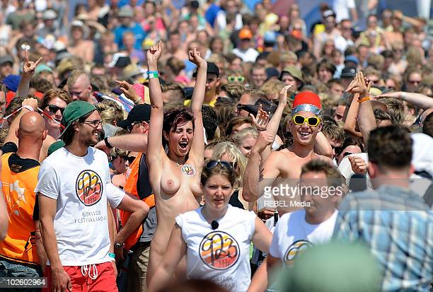 Naked festivalgoers prepare to take part in the annual Naked Run at the camp site on day 3 of the Roskilde Festival on July 3 2010 in Roskilde Denmark