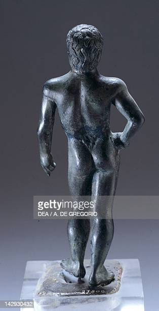 Naked figure in bronze rear view making an offering from Monte Capra Etruscan Civilization 420400 BC Bologna Museo Civico Archeologico