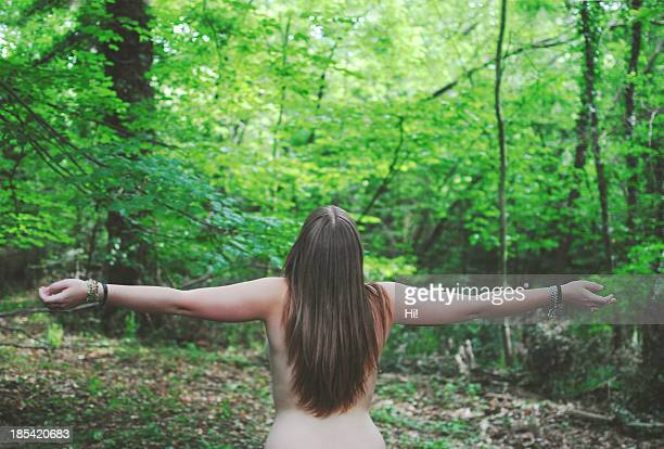 Naked girl in the woods.