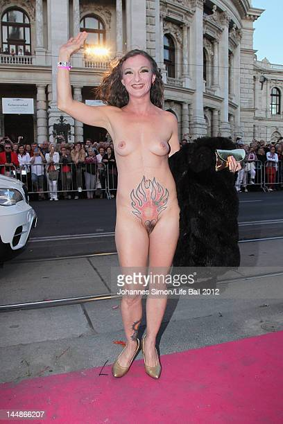 A naked guest adorned with body paint arrives for the Life Ball 2012 AIDS charity fundraiser at City Hall on May 192 012 in Vienna Austria
