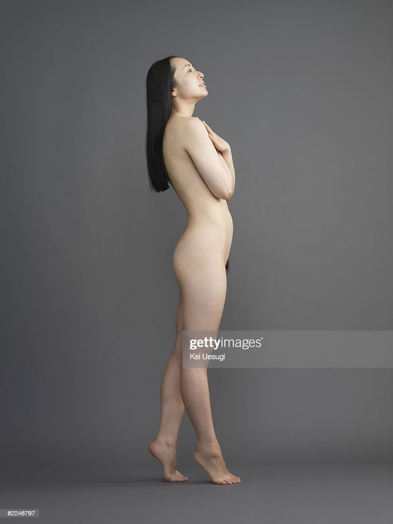 Naked Japanese woman standing on her toes : Stock Photo