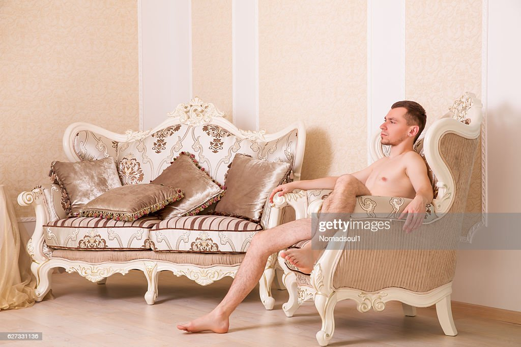 Naked Macho Man Sitting On Retro Chair Stock Photo