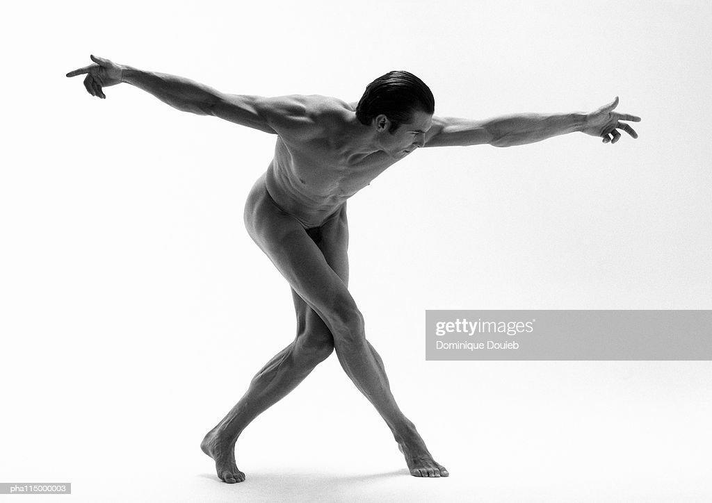 Naked man dancing, b&w. : Stockfoto