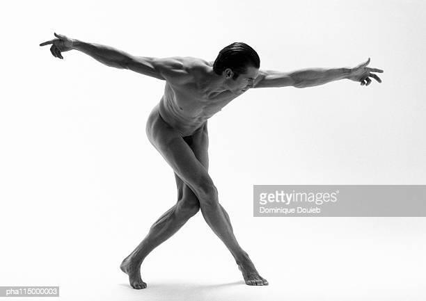 Naked man dancing, b&w.