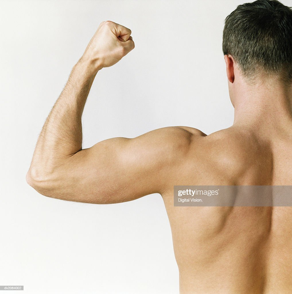 Naked Man Flexing His Muscles : Stock Photo