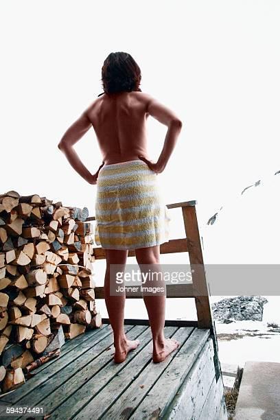 Naked man looking away