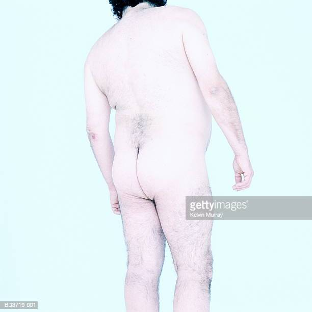 Naked man, rear view, mid section