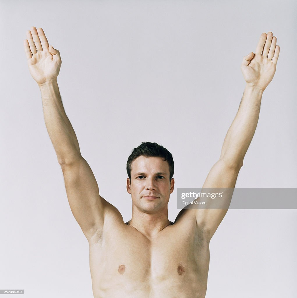 Naked Man With His Arms Upstretched : Stock Photo