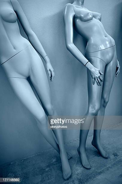 Naked mannequins sitanding up.