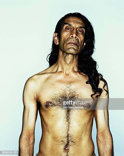naked mature man with long hair, portrait - hairy chest stock-fotos und bilder