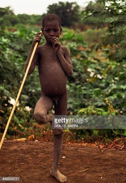 Naked Mursi baby Mago National Park Ethiopia