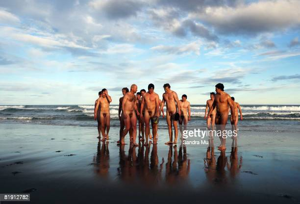 Naked rugby players walk from the surf after a quick swim once completing a nude rugby game at St Kilda Beach on July 12 2008 in Dunedin New Zealand...