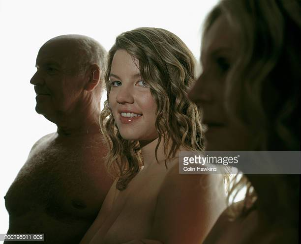 naked senior man, young and mature women, young woman smiling - uomini anziani nudi foto e immagini stock