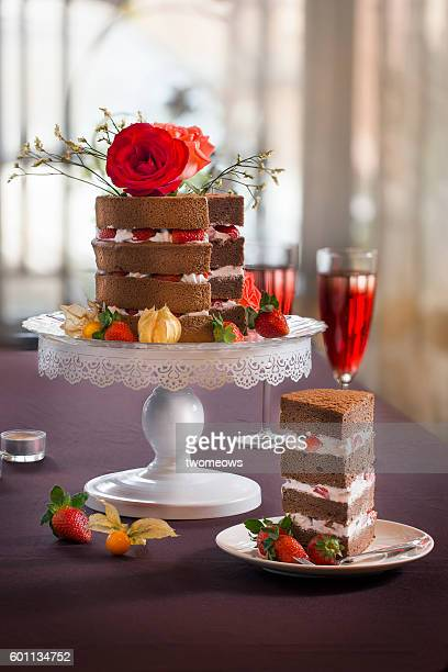 Naked style cake with roses table top shot.