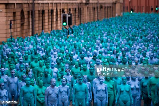 TOPSHOT Naked volunteers painted in blue to reflect the colours found in Marine paintings in Hull's Ferens Art Gallery participate in US artist...