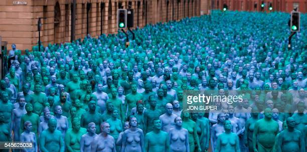 Naked volunteers painted in blue to reflect the colours found in Marine paintings in Hull's Ferens Art Gallery participate in US artist Spencer...