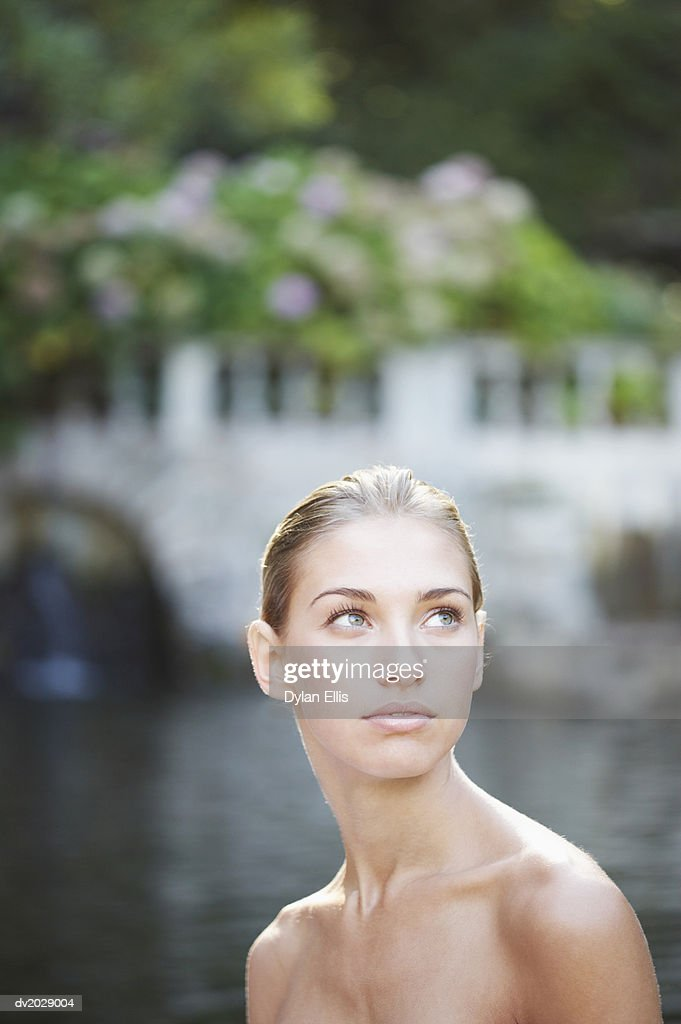 Naked Woman by a Lake : Stock Photo