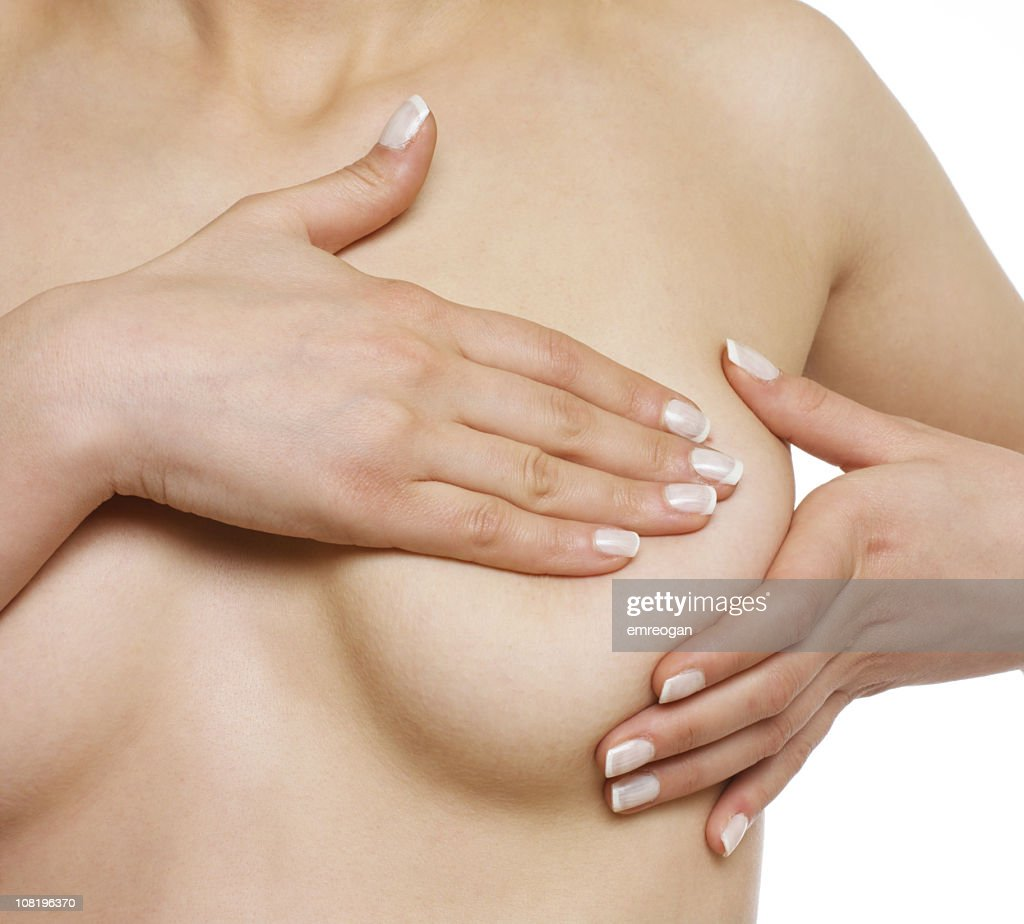 Naked Woman Giving Self Breast Exam : Stock Photo