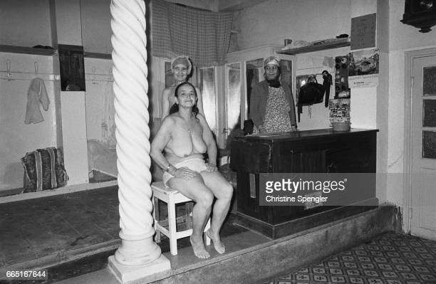 A naked woman in a hammam with the masseuse and cashier in the Casbah of Algiers