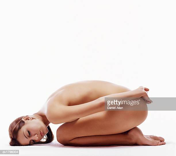 Naked woman in Fetal Position