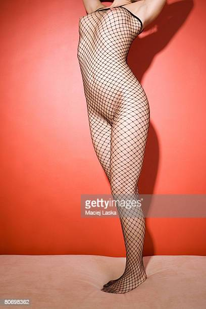 Naked woman in fishnet suit.