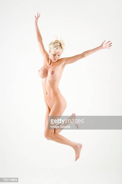 Naked woman jumping