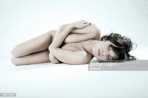 Naked Woman Lying Down on White Background