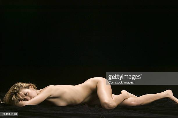Naked woman lying down