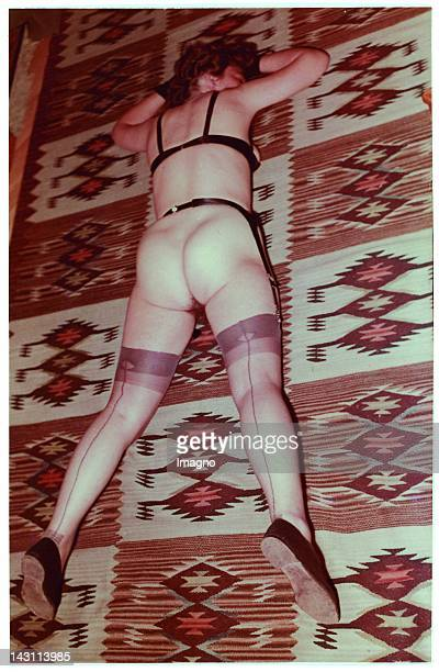 Naked woman lying on the flloor Snapshot Photograph Germany 1950
