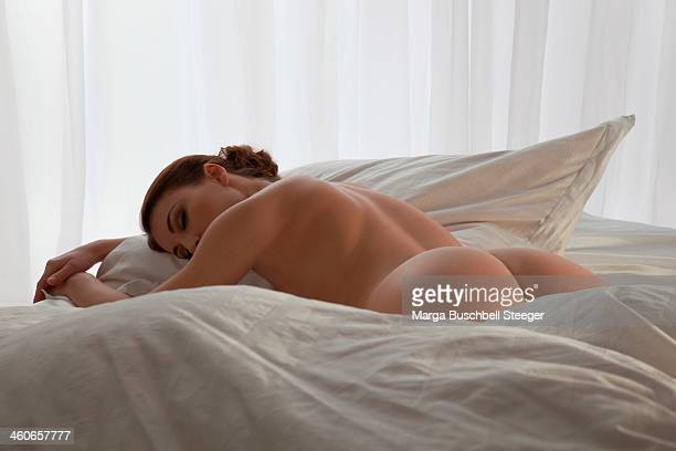 Naked woman on bed