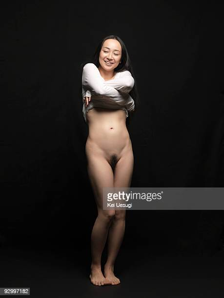 a naked woman. - dressed undressed women stock pictures, royalty-free photos & images