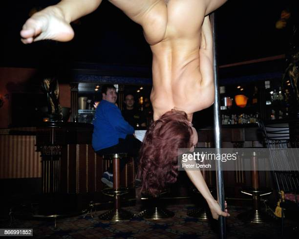 A naked woman pole dances for visitors at The Pascha a 12storey 9000 square metre brothel in Cologne Germany With about 120 prostitutes over 80...