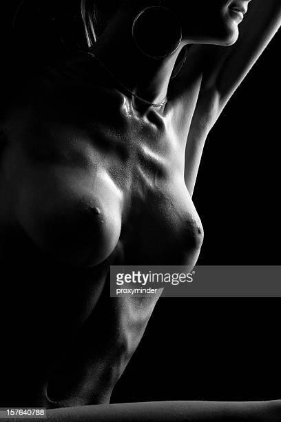 Naked woman posing in studio, (B&W)