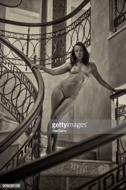 naked woman posing on the stairs - old nudists stock pictures, royalty-free photos & images