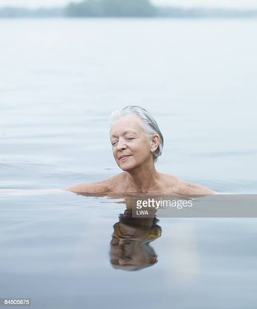 Naked Woman Relaxing in Lake
