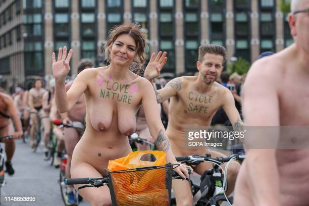 A naked woman rides her bike during the event Nude cyclists take part in the 16th annual naked bike ride by riding bicycles on Westminster Bridge as...