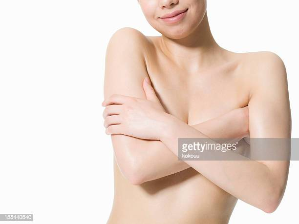 Naked woman sets her hand to a breast