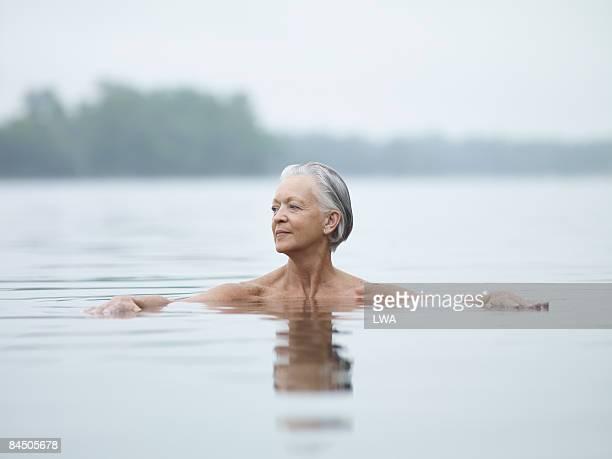Naked Woman Sitting in Lake