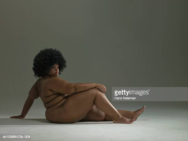 naked woman sitting on floor, portrait - images of fat black women stock photos and pictures