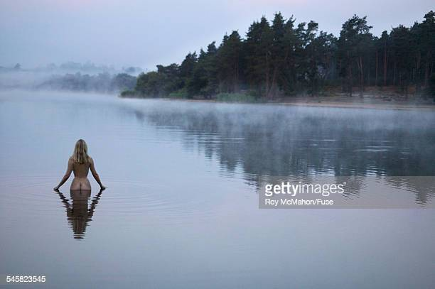 Naked Woman Standing in Lake