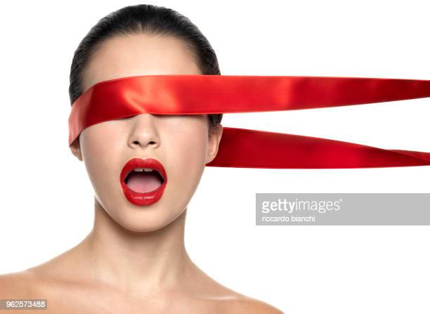 naked woman with red lips and red ribbon on her eyes - blindfolded stock photos and pictures