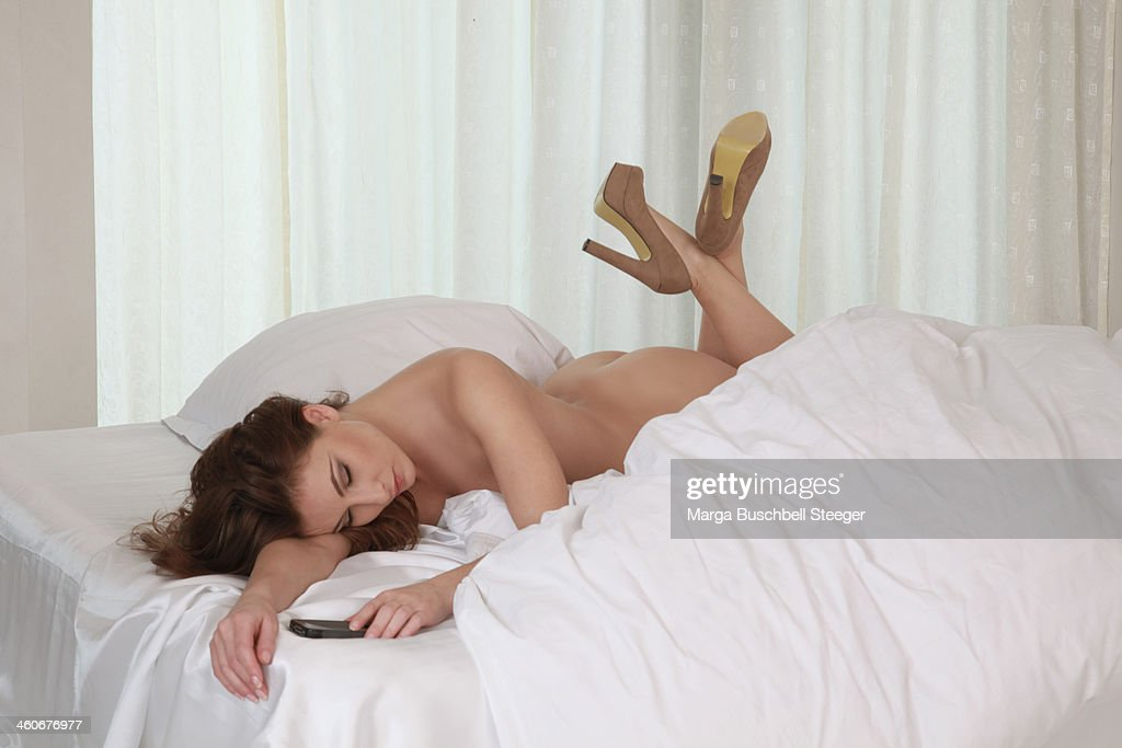 Naked woman on telephone