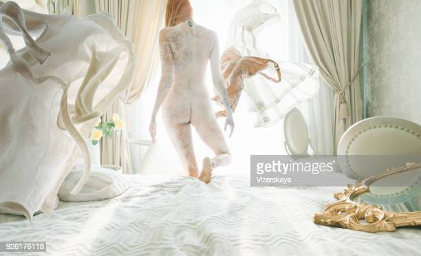 naked women with levitation clothes - naturism stock photos and pictures