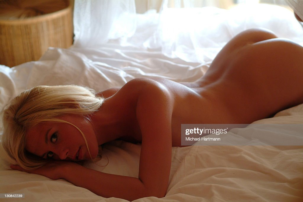 Naked Young Blonde Woman Laying On Her Stomach On A White -8692