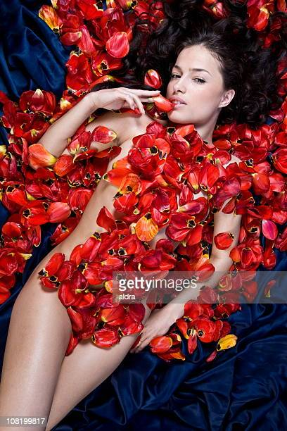 Naked Young Woman Laying with Tulip Petals All Over