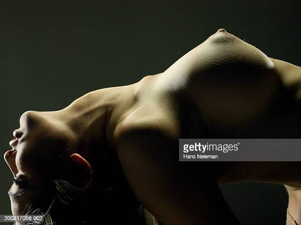 Naked young woman leaning back, arching back, close-up, profile