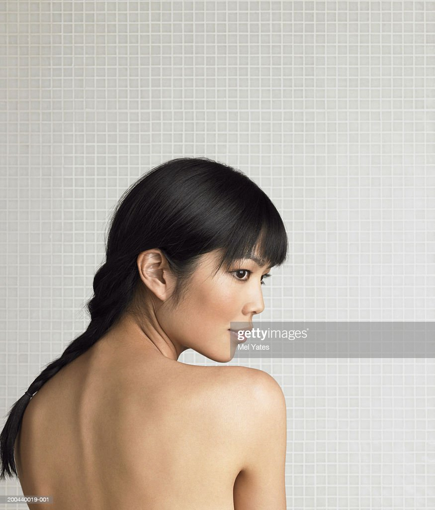 Young Woman Resting Chin On Mans Shoulder Outdoors At