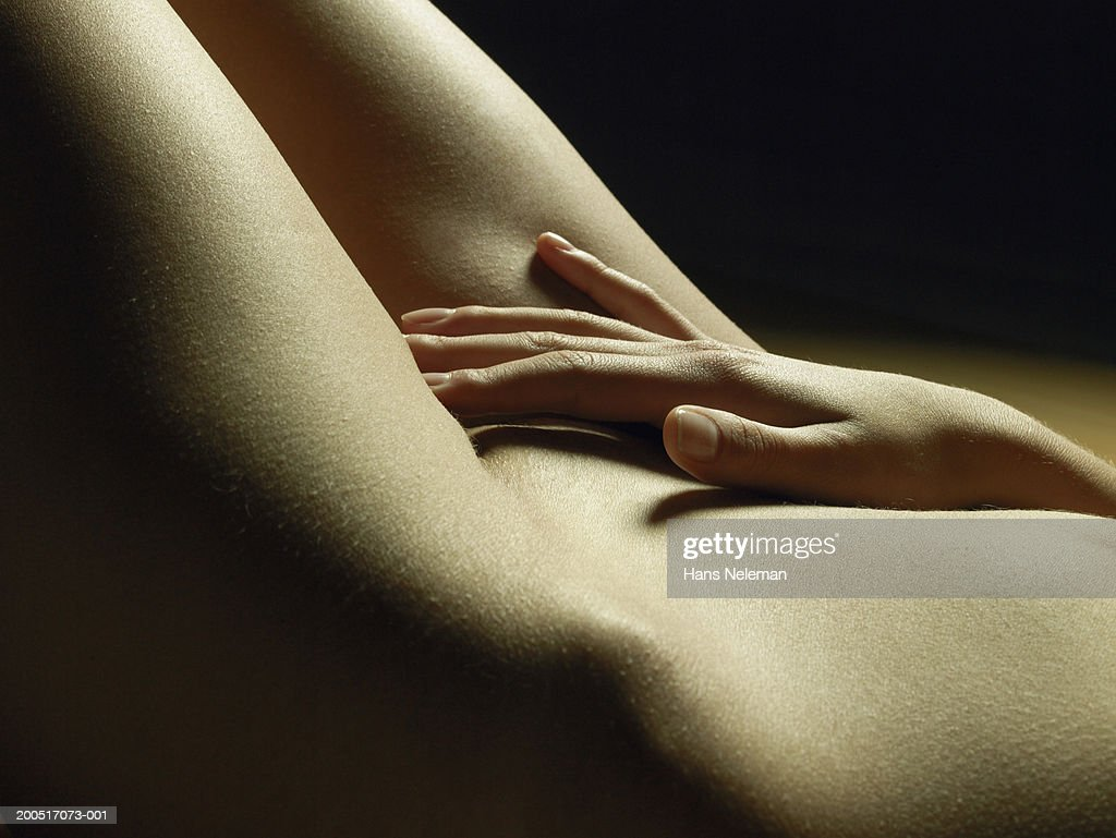 Naked Young Woman Lying On Back Fingers Between Legs -2530